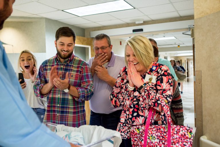 family joyfully reacting to meeting newborn twins