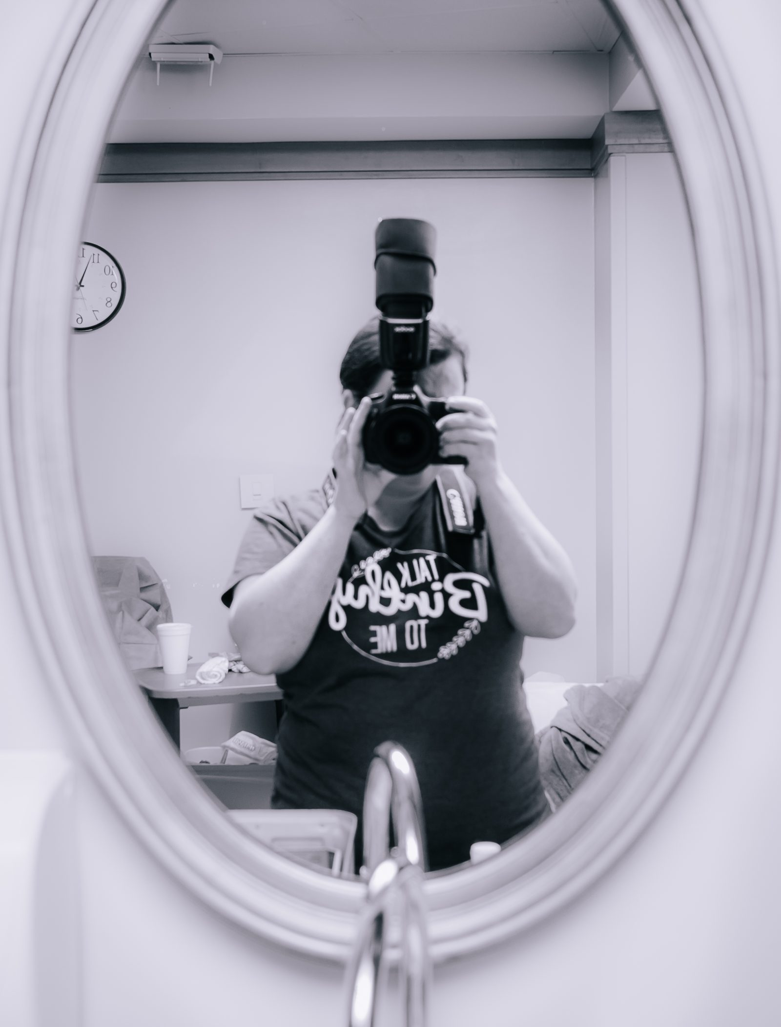 Selfie of a birth photographer in a hospital room mirror in celebration of Birth Photography Day